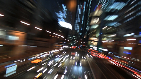 A photo of Japanese city traffic at night